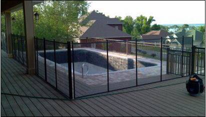 Down one side of a negative edge pool and on a raised composite deck.