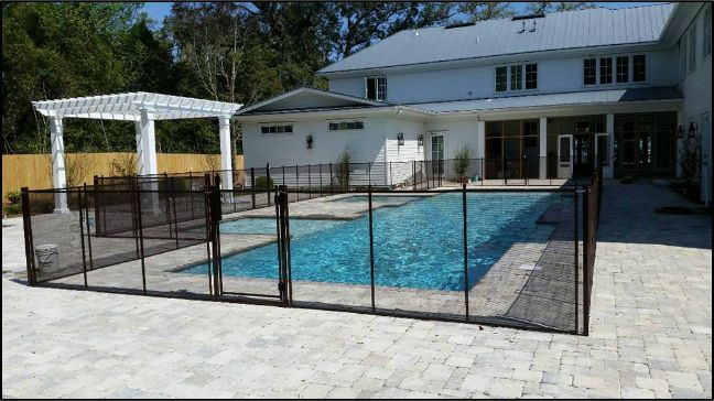 Large beautiful fence with 3 gates.