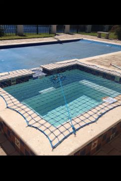 Pool Safety Cover with additional Pool Safety Net.